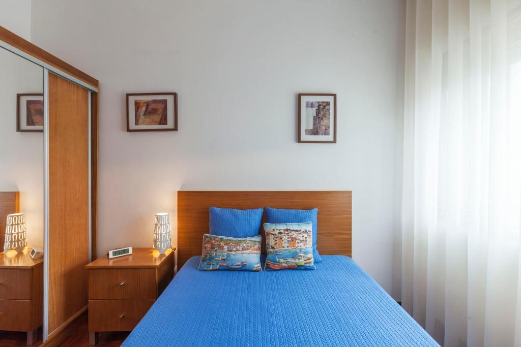 A bed or beds in a room at Apartment Camões