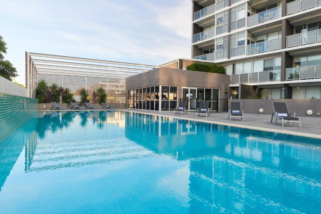 The swimming pool at or near Chifley Apartments Newcastle