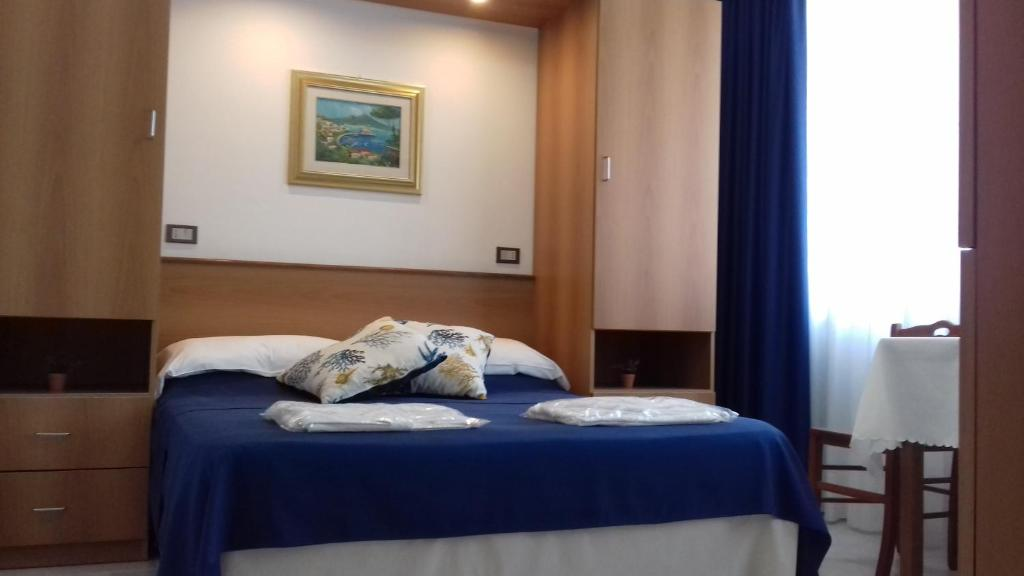 A bed or beds in a room at Residence Hotel Villa Laura
