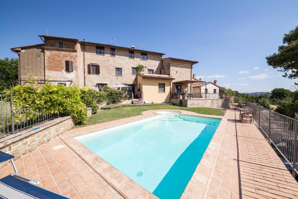 The swimming pool at or near Umbria Country Shelter