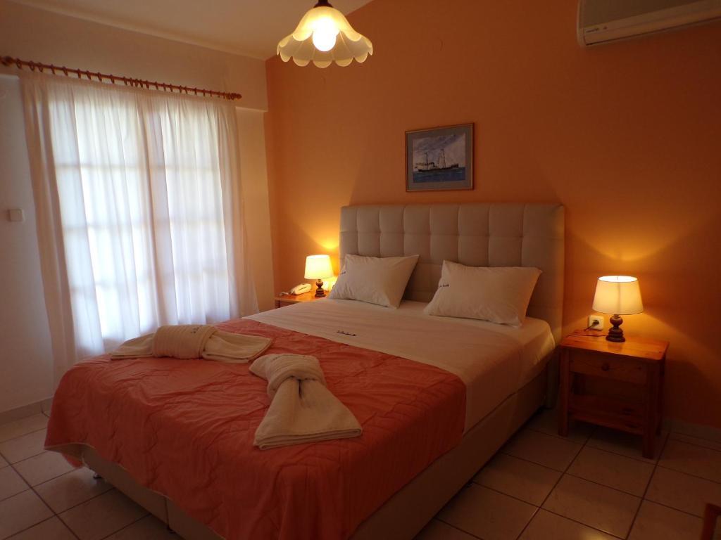 Ένα ή περισσότερα κρεβάτια σε δωμάτιο στο Le Due Sorelle