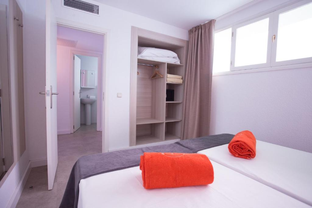 A Bed Or Beds In Room At Bh Mallorca Apartments