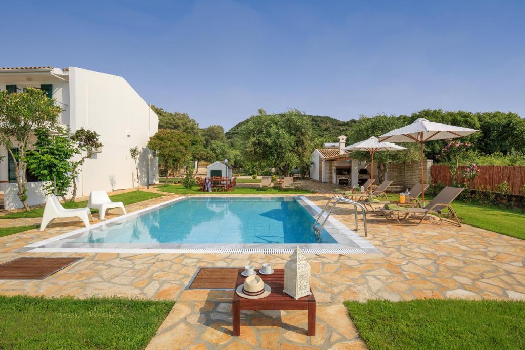 The swimming pool at or near Skales Villas