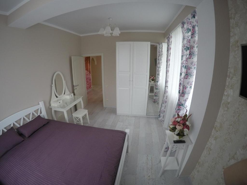Кровать или кровати в номере Квартира
