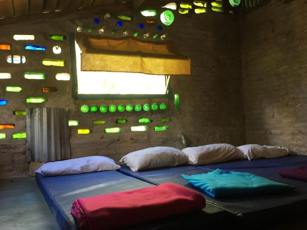 A bed or beds in a room at El Malon Base y Cabanas
