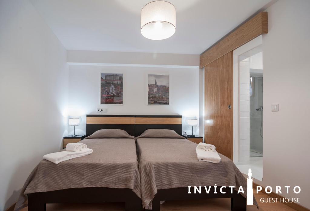 Vuode tai vuoteita majoituspaikassa Invicta Porto Guest House