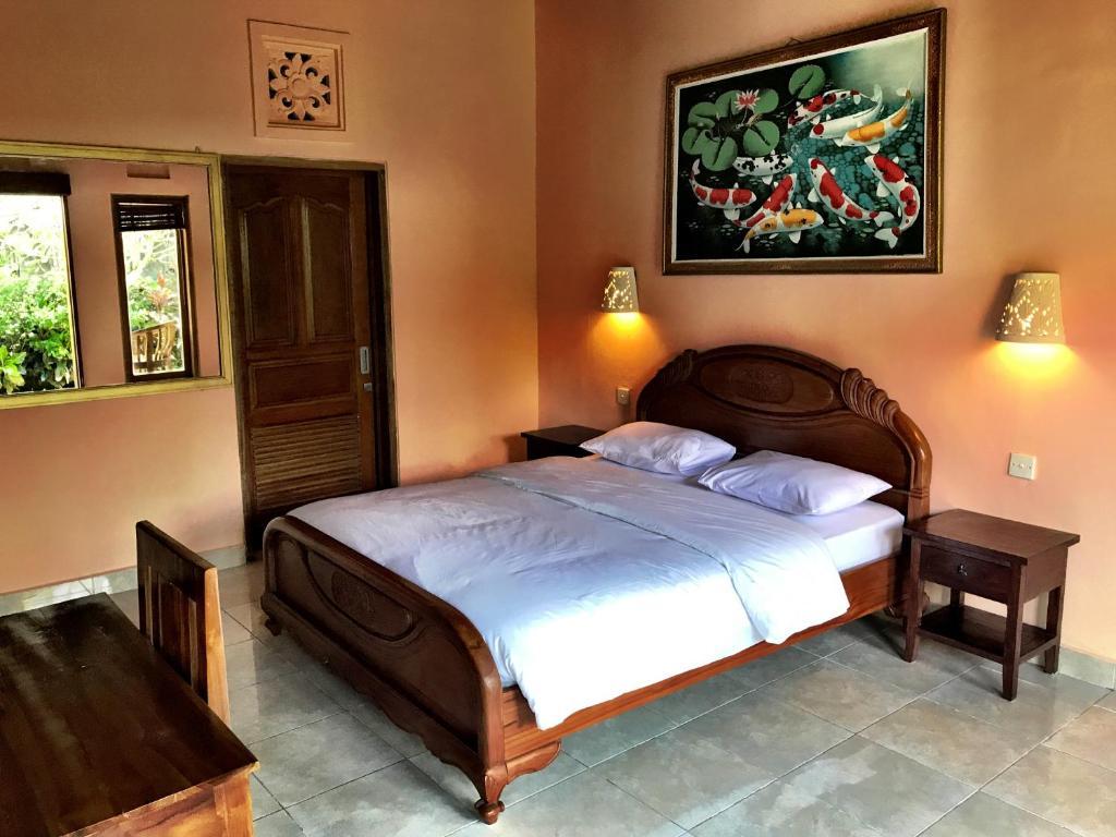 Un ou plusieurs lits dans un hébergement de l'établissement Nari Homestay