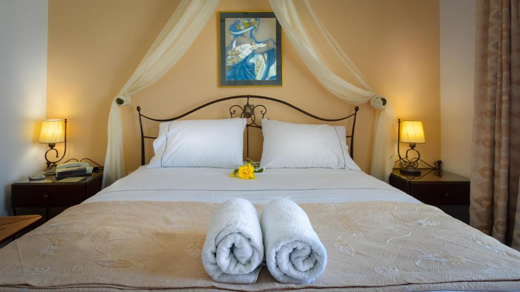 A bed or beds in a room at Sunset Studios & Apartments Adults Only