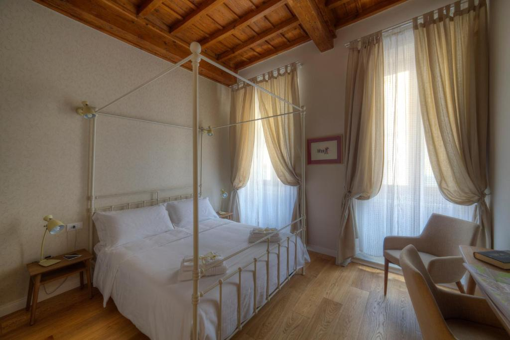 A bed or beds in a room at Assaporarte