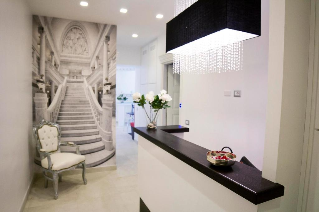 The lobby or reception area at Roman Holidays Boutique Hotel