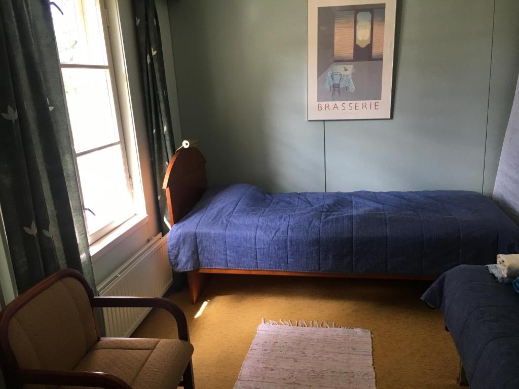 Vuode tai vuoteita majoituspaikassa Kuuman Maatilamajoitus
