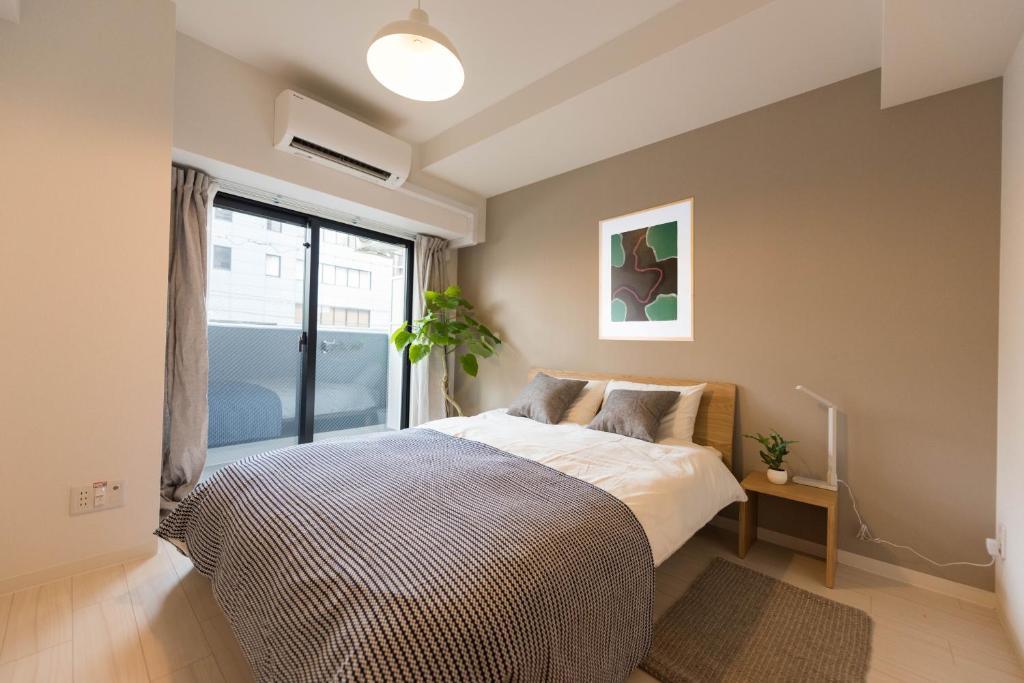 大阪川House旅行主題公寓房間的床