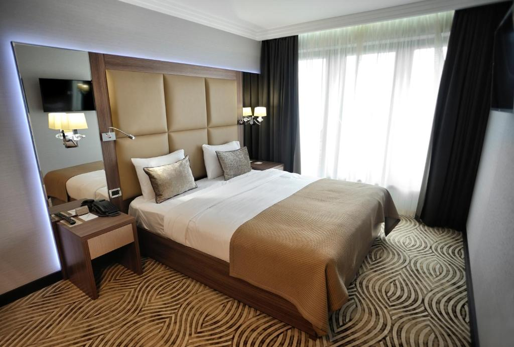A bed or beds in a room at Premier Hotel Dnister