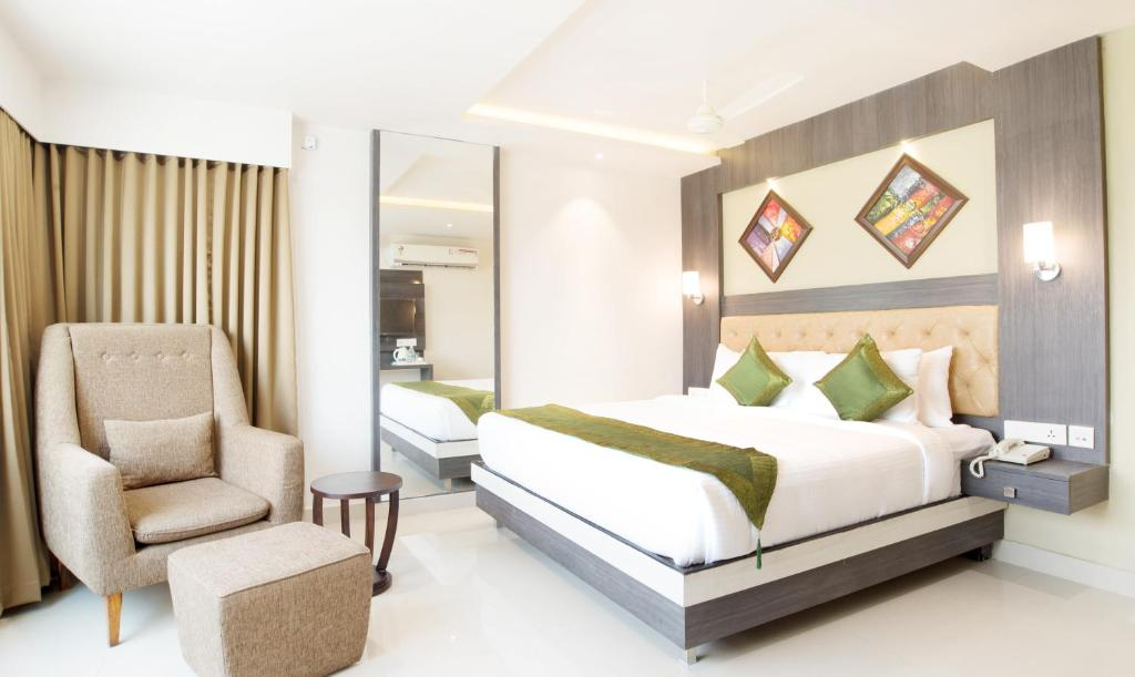 A bed or beds in a room at Treebo Trend Olive Tree