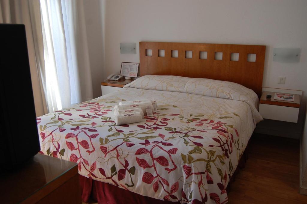 Säng eller sängar i ett rum på Gran Hotel Vedra