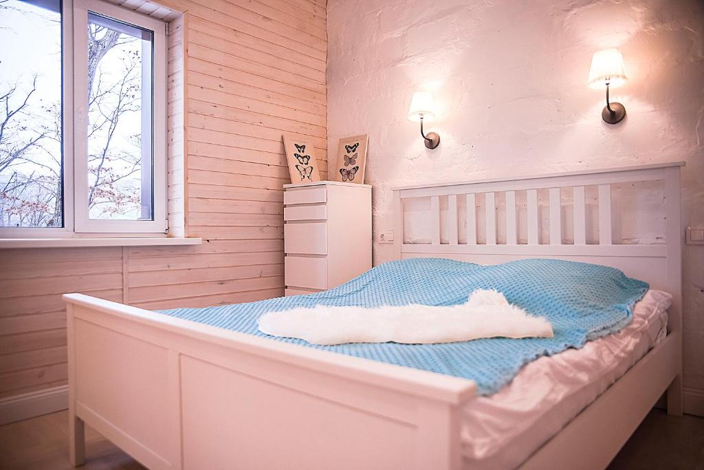 A bed or beds in a room at Sweet Home Kometa