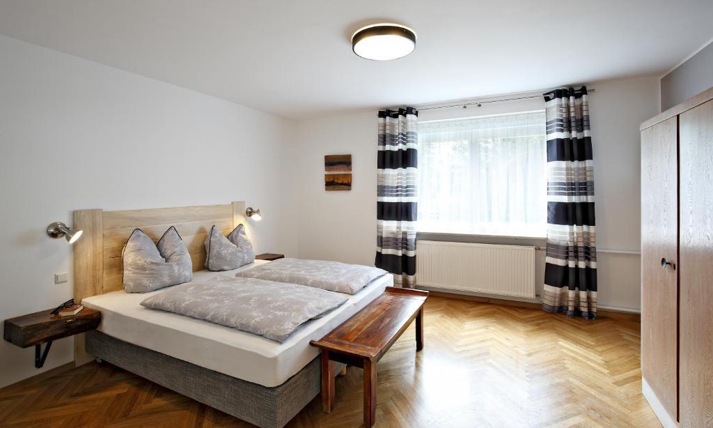 A bed or beds in a room at Villa Spreewaldgarten