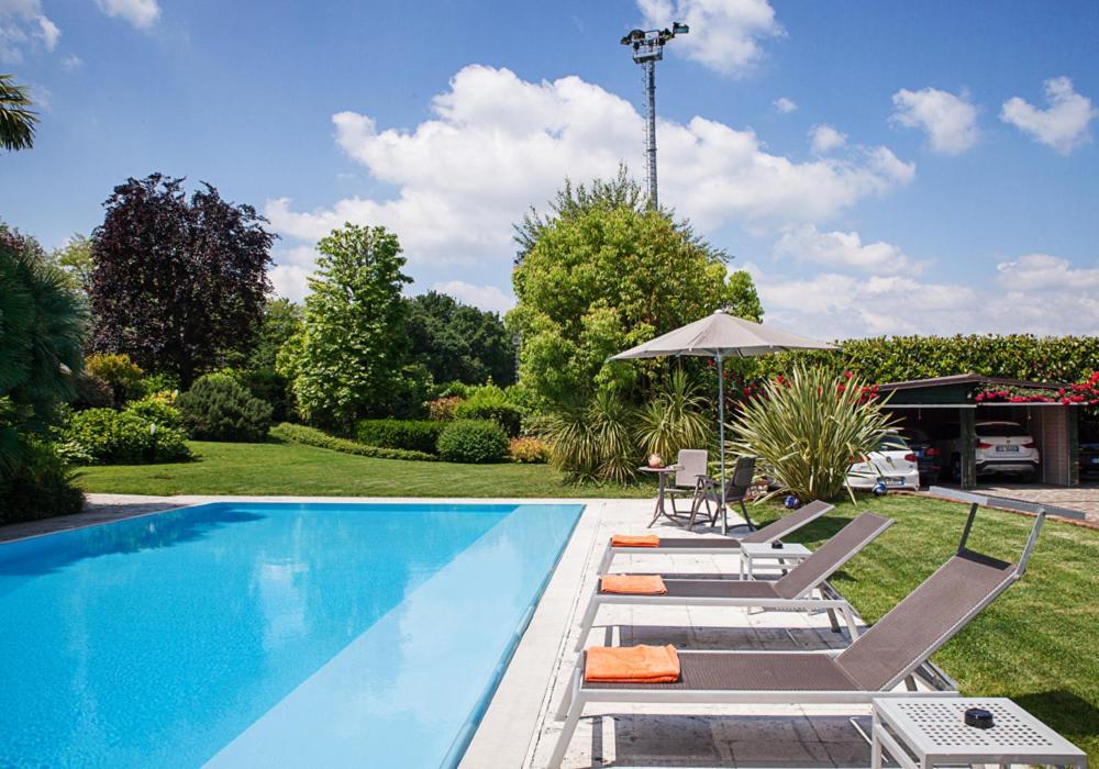The swimming pool at or near B&B Villa Adriano