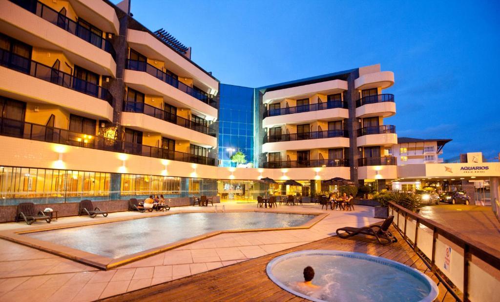 The swimming pool at or near Aquarios Praia Hotel