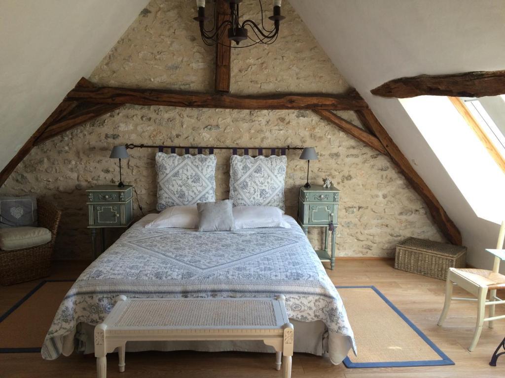 Un ou plusieurs lits dans un hébergement de l'établissement La Bihourderie