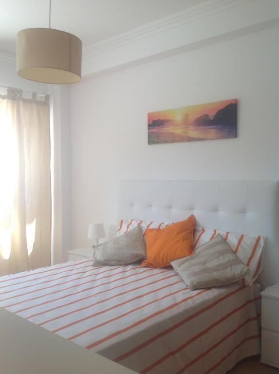 A bed or beds in a room at Summer House Camarate