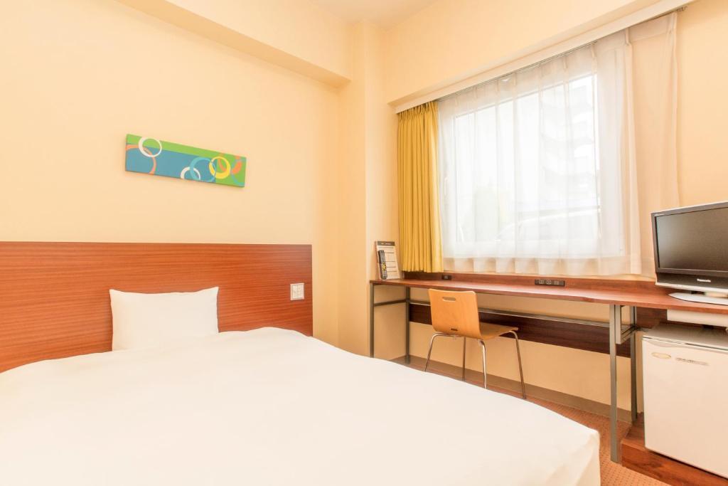 ポイント1.広々ベッドとバスルーム