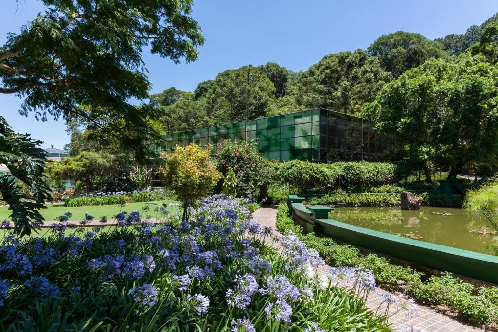 A garden outside Unique Garden Hotel & SPA