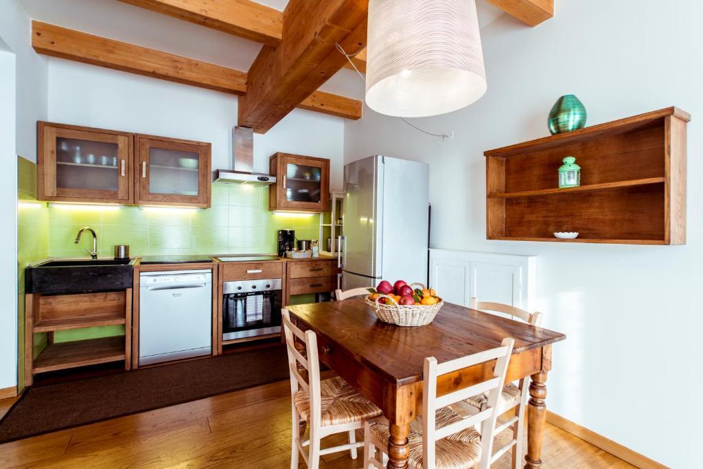 Kuchyň nebo kuchyňský kout v ubytování Appartamento Rocchetta