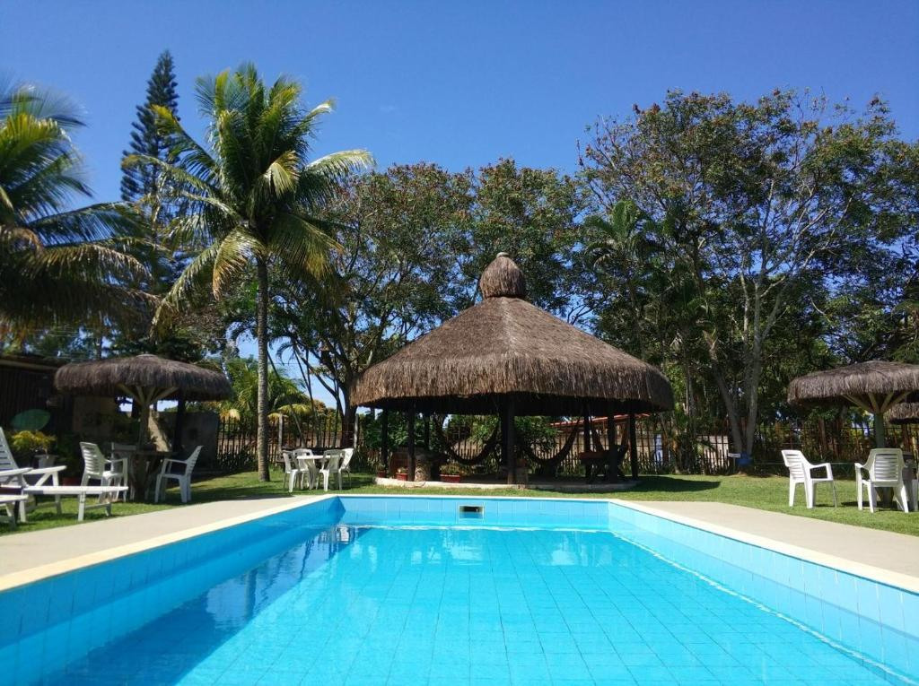 The swimming pool at or near Pousada Chacara Feliz