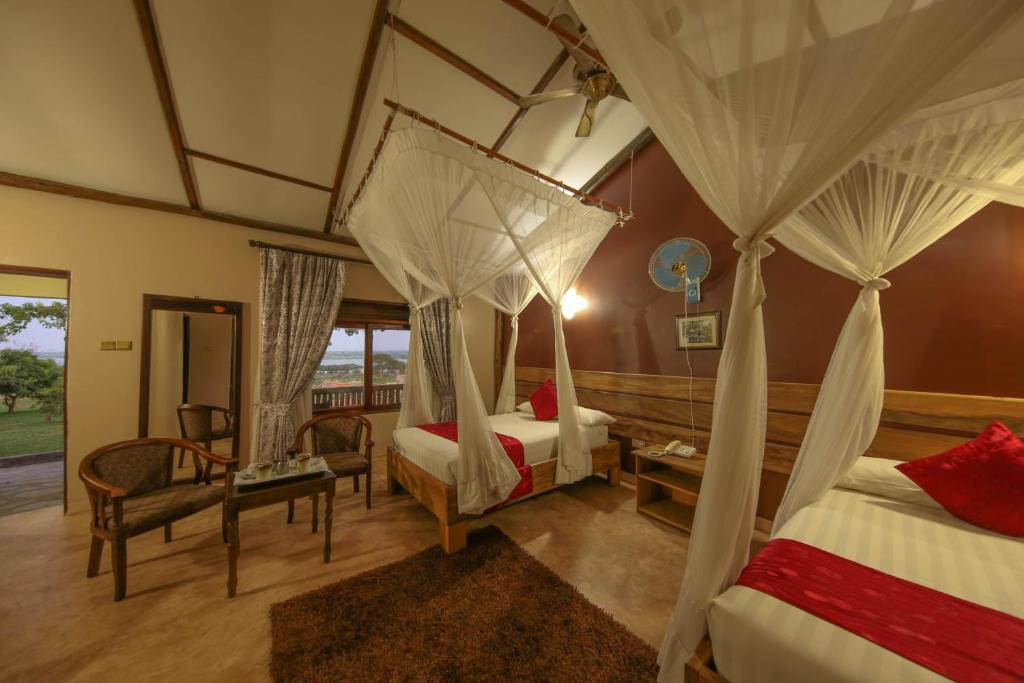 A bed or beds in a room at Pakuba Safari Lodge