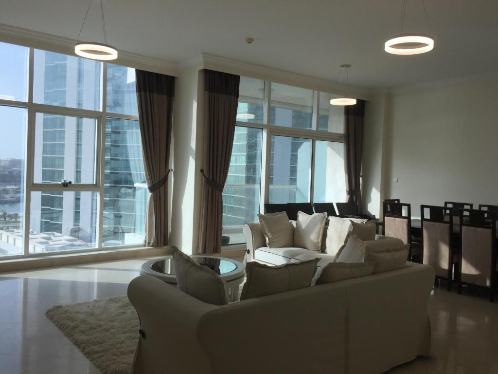A Seating Area At Four Bedroom Apartment Dorra Bay Tower