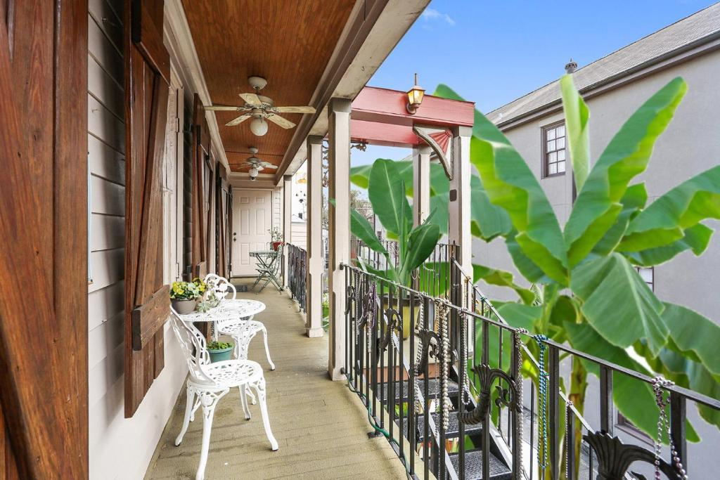 A balcony or terrace at 1870 Banana Courtyard French Quarter B&B