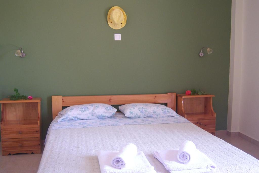 A bed or beds in a room at Melina Apartment