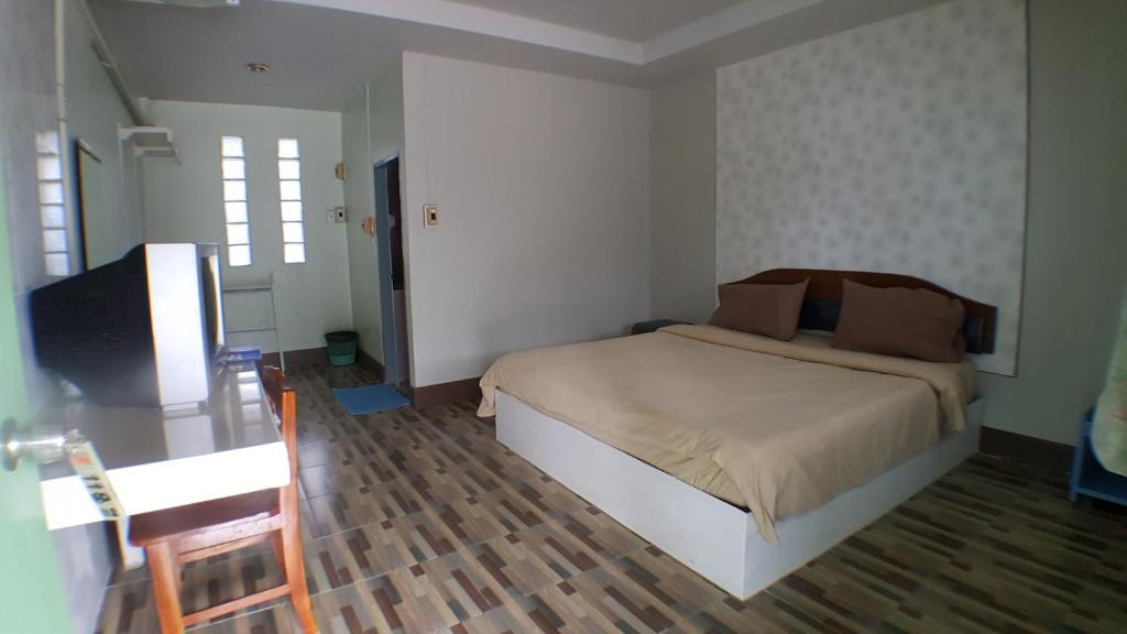 A bed or beds in a room at Erawan Resort Buriram
