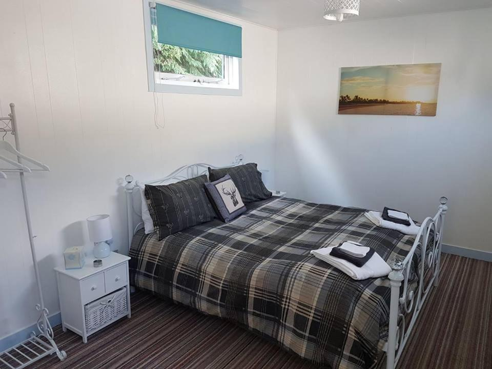A bed or beds in a room at Broadmyre Guest House