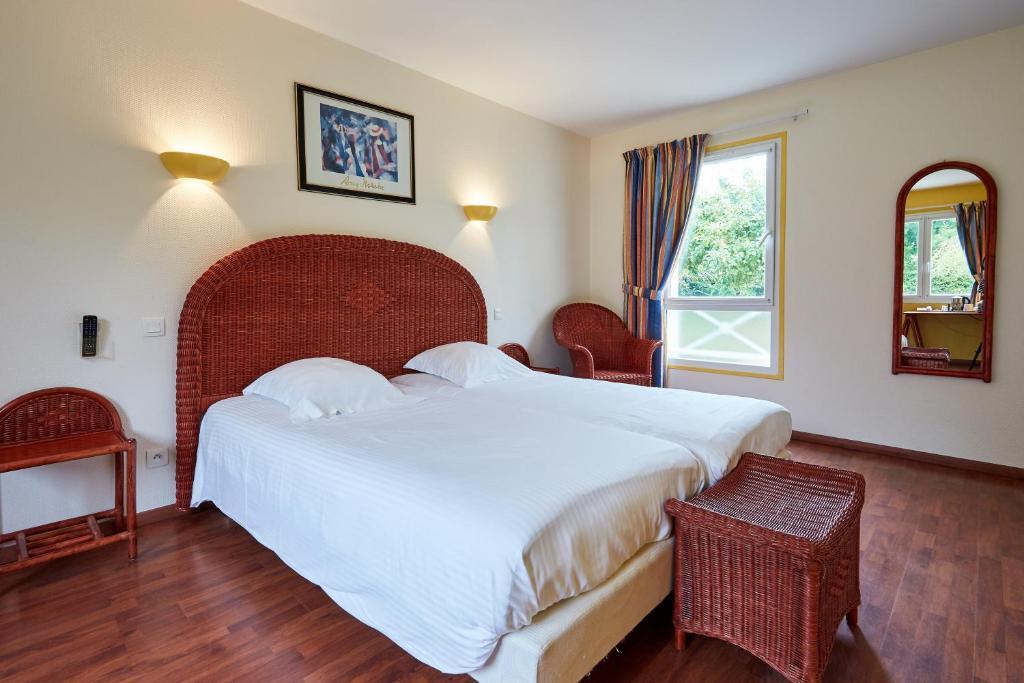 Un ou plusieurs lits dans un hébergement de l'établissement Domaine de L'Hostreiere