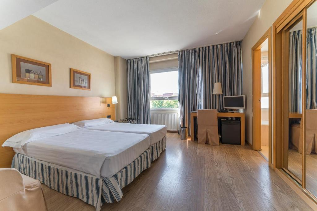 A bed or beds in a room at Infanta Mercedes