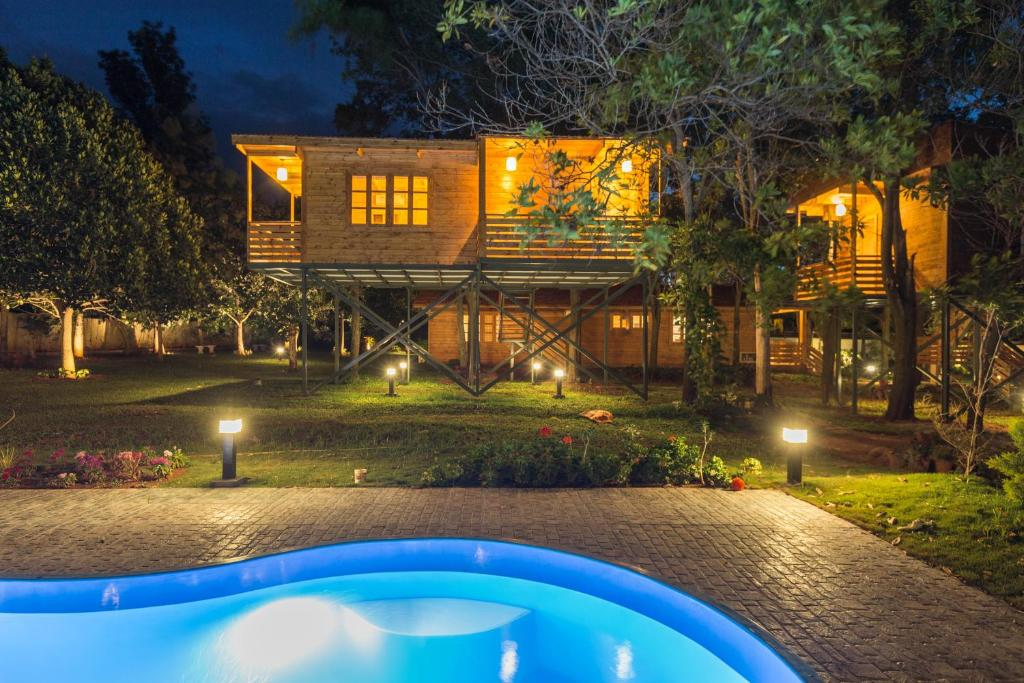 Vacation home calista millennia chik ball pur india for Kodaikanal cottage with swimming pool