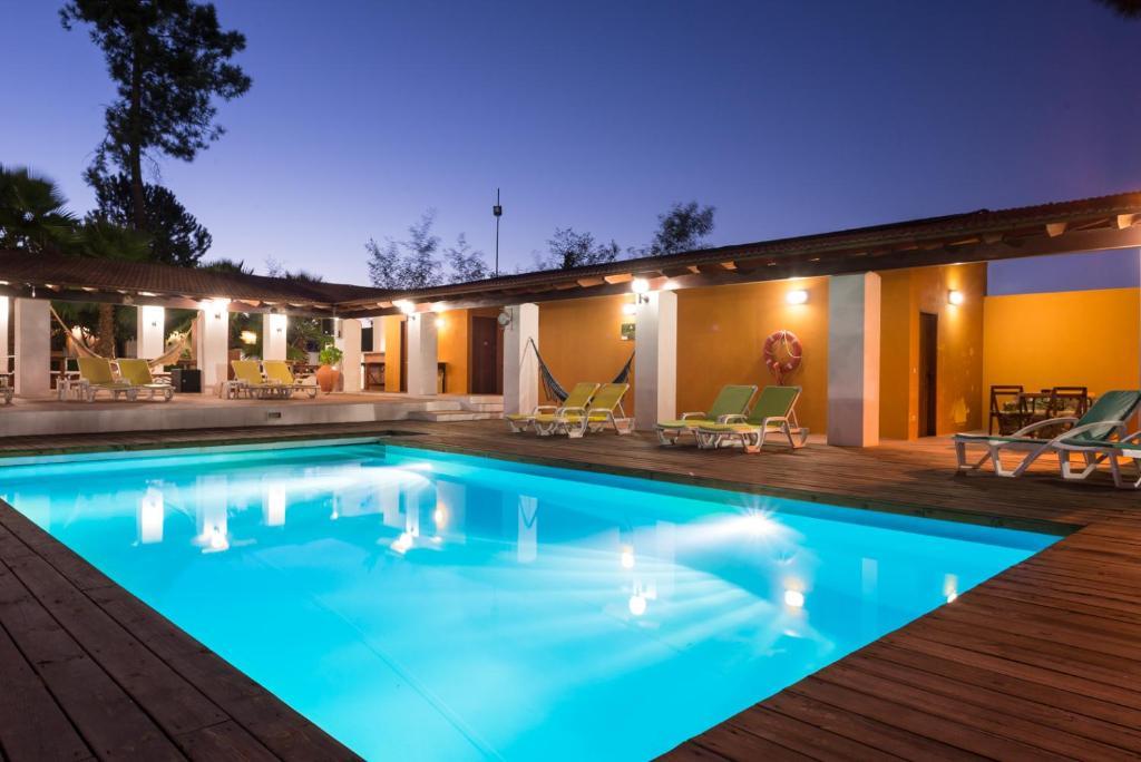 The swimming pool at or near Quinta da Mimosa