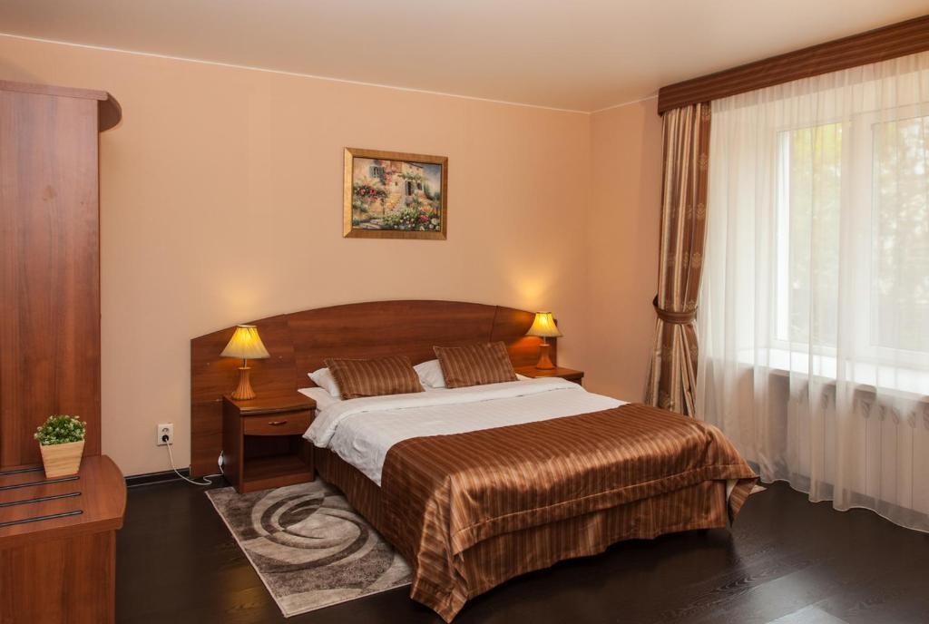 Кровать или кровати в номере Отель Морион