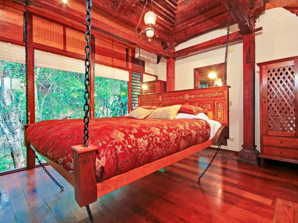 A bed or beds in a room at Mt Warning Rainforest Retreat