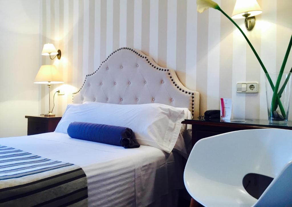 A bed or beds in a room at Hospederia De Los Reyes