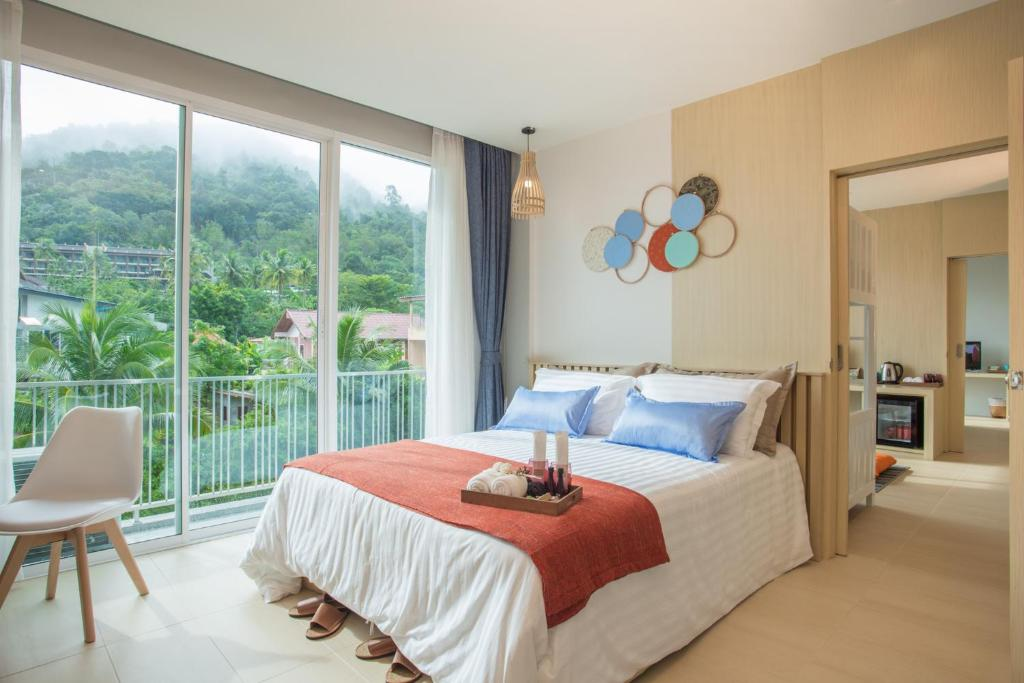 A bed or beds in a room at LaRio Hotel Krabi