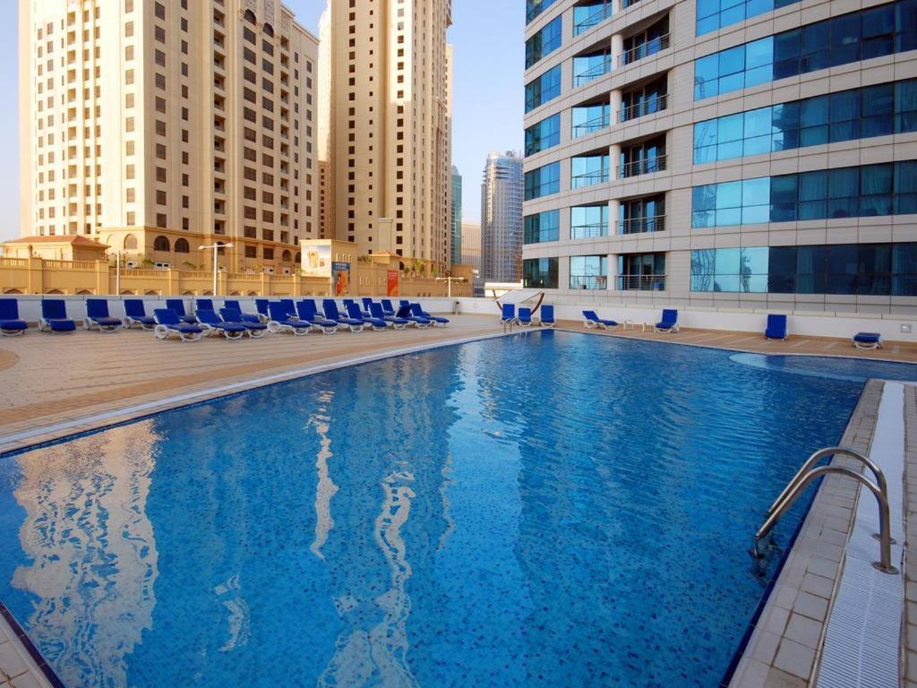 The Swimming Pool At Or Close To Four Bedroom Apartment Dorra Bay Tower