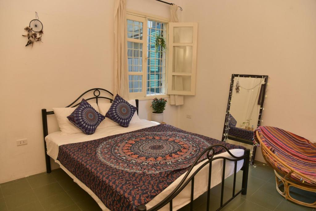 A bed or beds in a room at Dreamcatcher Homestay
