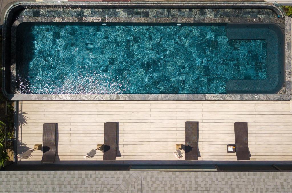 The swimming pool at or near Kamala Resotel