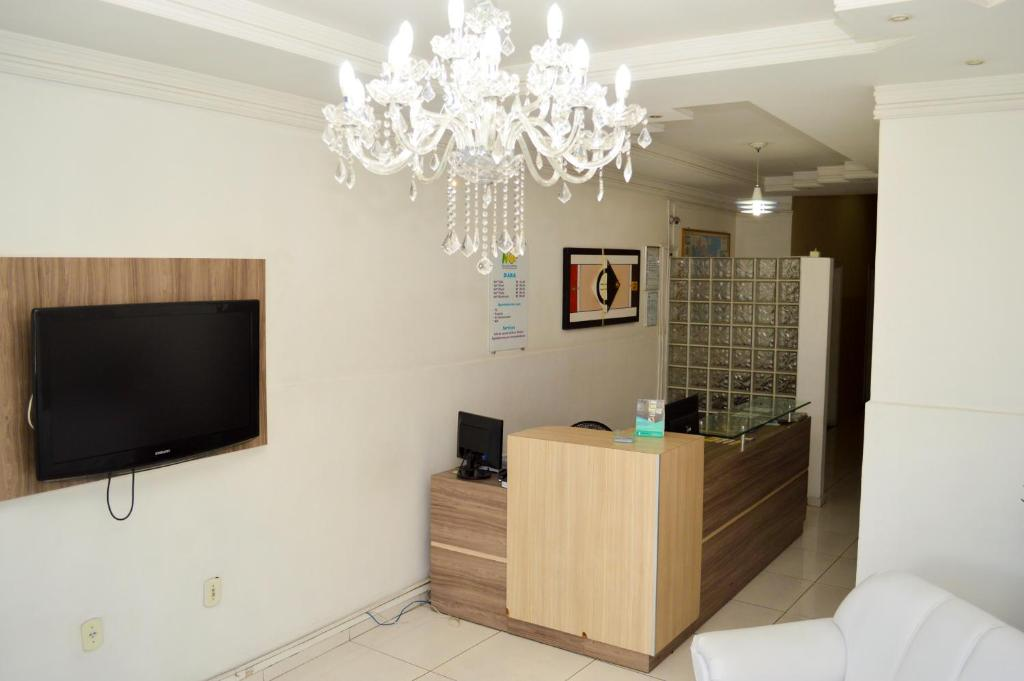 A television and/or entertainment center at Hotel Novo Sol