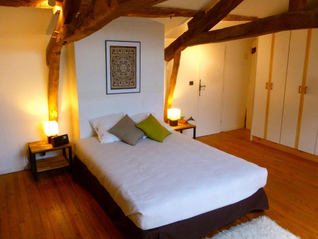 Un ou plusieurs lits dans un hébergement de l'établissement Gite CAP de BOUÉOU