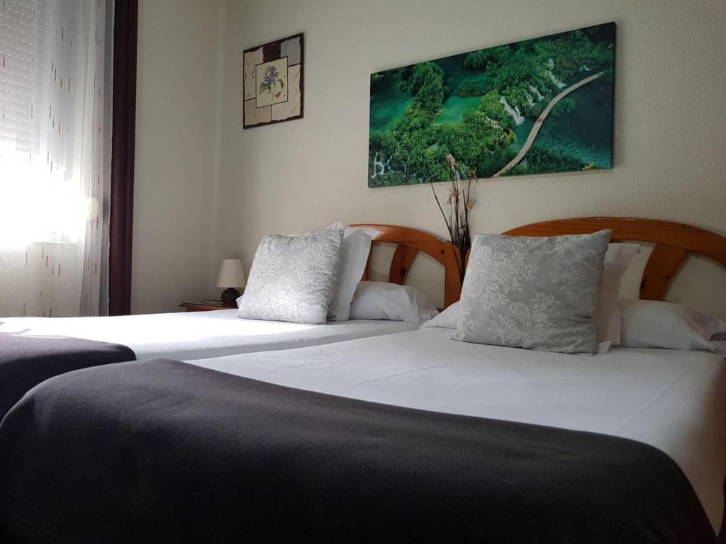 Cama o camas de una habitación en Pensión Leyre