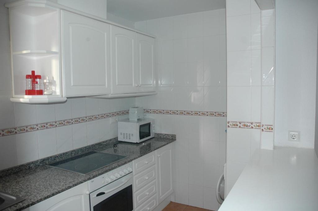 Apartamentos La Giralda fotografía